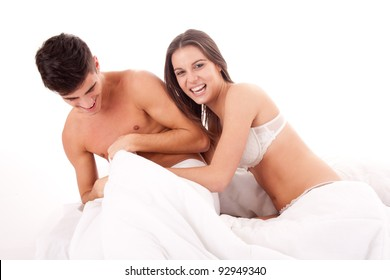 Portrait of a happy young couple relaxing on the bed