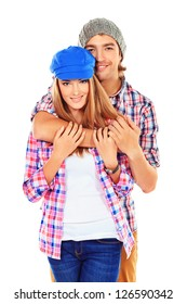 Portrait of a happy young couple standing together over white background