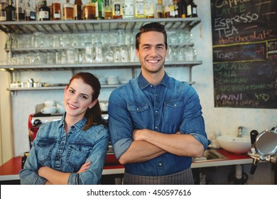 Portrait of happy young co-workers at cafeteria