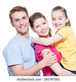 Portrait of the happy young family with child in multicolor shirts - isolated on white background.