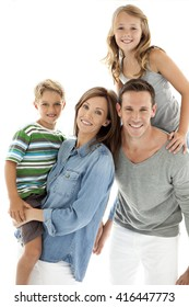 Portrait of a happy young family of four people