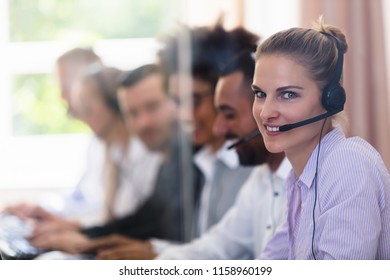 Portrait Of A Happy Young Female Customer Service Executive