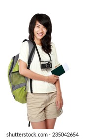 portrait of happy young girl with backpack and passport