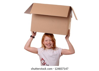 Portrait of a happy young girl carrying a large box