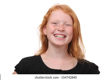 Portrait of a happy young girl with freckles on white background