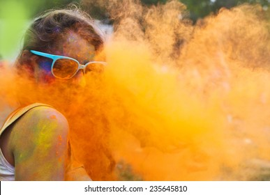 Portrait of happy young girl on holi color festival