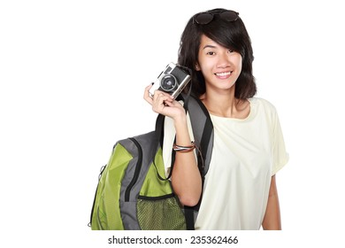 portrait of Happy young girl with vintage camera going on vacation