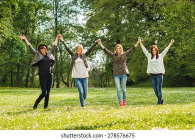 Portrait of happy young girls standing in the park.Friendship