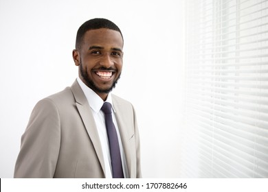 Portrait of happy young handsome african american businessman in the office