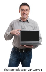 Portrait of happy young man advertising laptop over white background