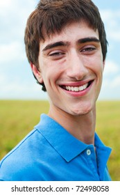 portrait of happy young man against blue sky
