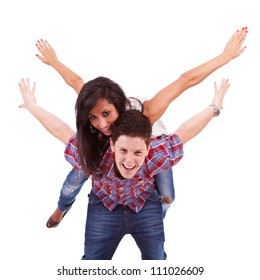 Portrait of happy young man carrying his girlfriend on his back with their hands outstretched