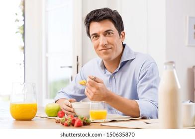 Portrait Of Happy Young Man Having Healthy Breakfast