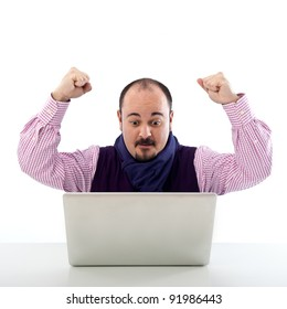 Portrait of a happy young man looking at laptop against white background.