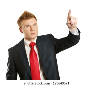 Portrait of a happy young man pointing at something interesting over white background