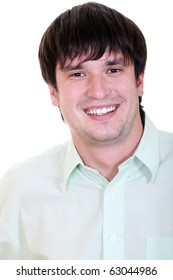 Portrait of a happy young man standing against white background