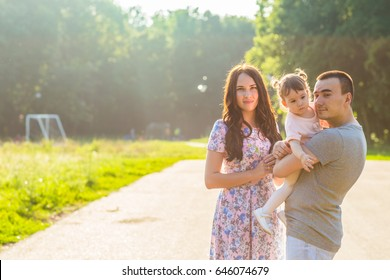Portrait of happy Young Mixed Race Ethnic Family Outdoors