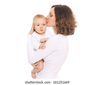 Portrait of happy young mom kissing her baby