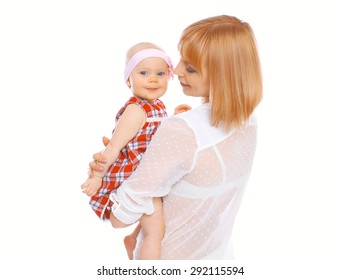 Portrait of happy young mother and baby on a white background