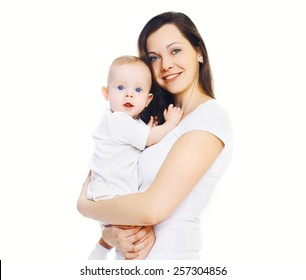 Portrait of happy young mother holding on hands her baby
