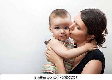 portrait of happy young mother and toddler on white and grey background
