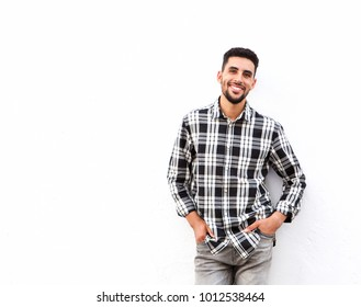 Portrait of happy young north african man smiling against white background