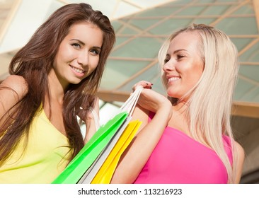 Portrait of happy young shopping together