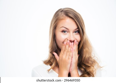 Portrait of a happy young woman covering her mouth isolated on a white background. Looking at camera