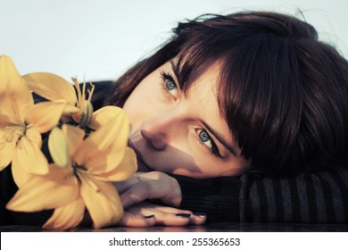 Portrait of happy young woman with a flowers