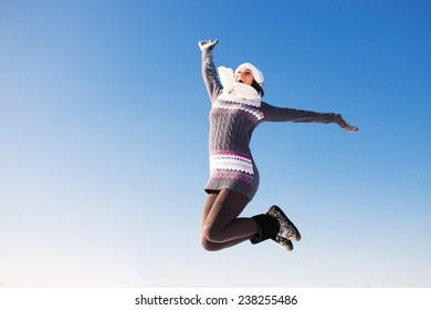 Portrait of happy young woman have fun at beautiful sunny winter day