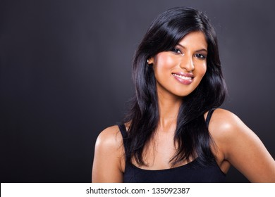 portrait of happy young woman isolated on black background