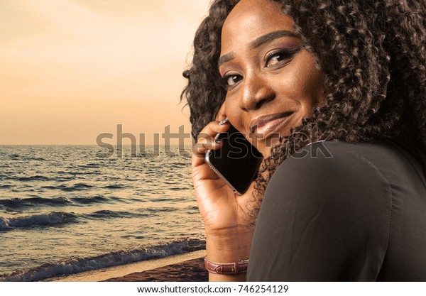 Portrait of happy young woman on the phone isolated