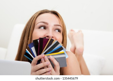 Portrait Of Happy Young Woman Shopping With Credit Card