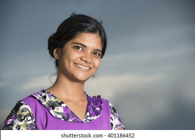 Portrait of happy young woman smiling, looking at camera.