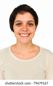 portrait of a happy young woman smiling on white background