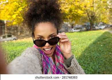 Portrait of a happy young woman taking selfie