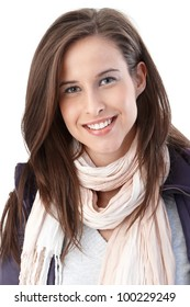 Portrait of happy young woman wearing trendy scarf and casual jacket smiling at camera.
