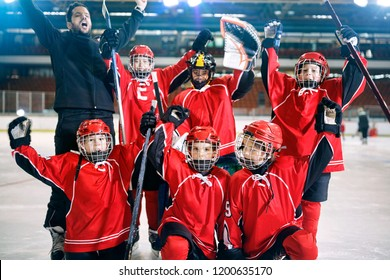 portrait of happy youth boys players team ice hockey