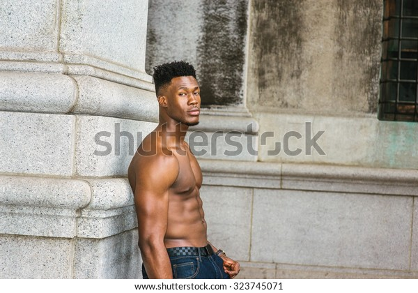 Young Handsome Man Holding Gun Stock Photo (Edit Now) 98575601