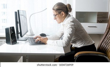 Portrait of hardworking beautiful businesswoman in office