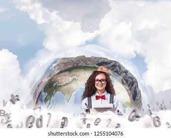 Portrait of hard-working female writer using typing machine while sitting at the table with flying letters and panoramic Earth globe among cloudy skyscape on background. Elements of this image