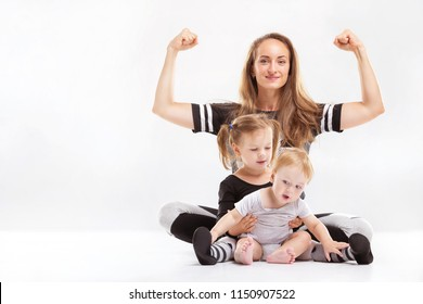 Portrait of healthy family of mother rising hands and playing children isolated at white background.