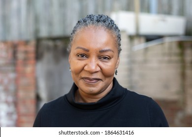 Portrait of a healthy and happy middle-aged African woman living with HIV - Shutterstock ID 1864631416