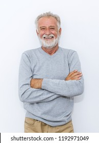 Portrait of healthy happy smile senior elderly caucasian old man with arm crossed isolated on white. Golden age grand father healthcare cheerful lifestyle, freedom relax retirement concept