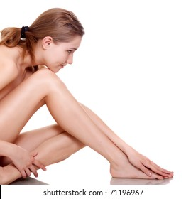 portrait of healthy smiling naked woman on white background