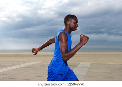 Portrait of healthy young african american man jogging at beach
