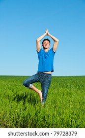 portrait of healthy young man doing yoga against sky