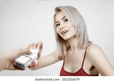 portrait of Healthy Young Woman Refusing To Take Cigarette From Pack. positive concept of smoking cigarettes