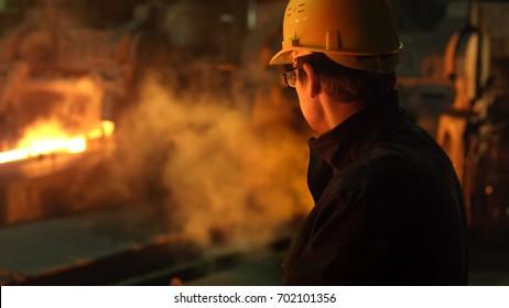 Portrait of Heavy Industry Technician in Hard Hat in Foundry. Industrial Environment.
