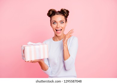 Portrait of her she nice attractive lovely sweet fascinating cheerful cheery glad girl holding in hands bow ribbon box isolated over pink pastel background